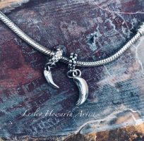 toothandclaw silver charm